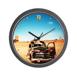 Broken Down Car In Desert Wall Clock