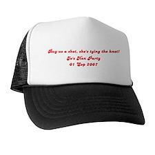 Buy us a shot, she's tying th Trucker Hat