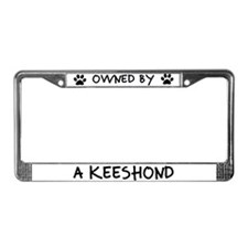 Owned by a Keeshond License Plate Frame