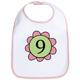 nine pink/green flower bib