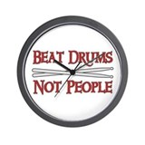 Beat Drums Not People Wall Clock