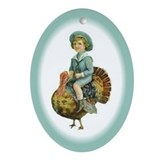 Boy Riding Thanksgiving Turkey Oval Ornament