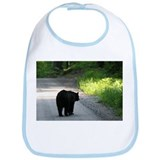 black bear walking on road Bib