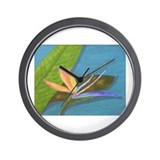 BIRD OF PARADISE ON BLUE WATE Wall Clock