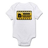 Warning Dollhouse Collector Onesie
