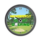 Monserrat is Out Golfing - Wall Clock