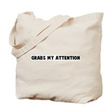 Grabs my attention Tote Bag
