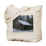 Log Cabin In Wintertime Tote Bag