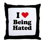 I love being hated Throw Pillow