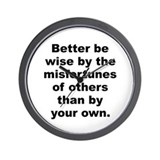 Better be wise by the misfortunes of others than b Wall Clock