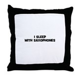 I sleep with Saxophones Throw Pillow