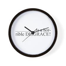 _______ is a hor-rible DISGRA Wall Clock