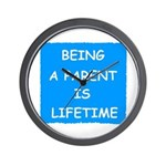 BEING A PARENT IS LIFETIME Wall Clock