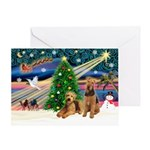 XmasSunrise/2 Airedales Greeting Card