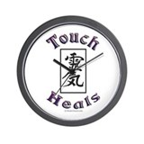 Touch Heals Wall Clock