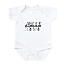 """My Son Is An Orthodontist"" Infant Bodysuit"