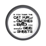 Cat fur on clothes Wall Clock