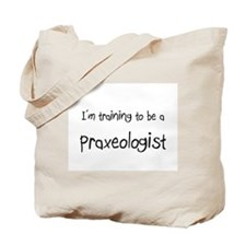 I'm training to be a Praxeologist Tote Bag