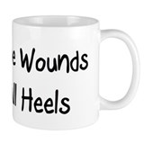 Time wounds all heels Mug