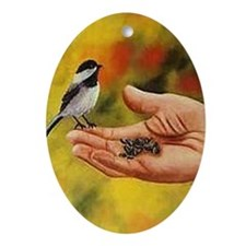 Chickadee in HandOrnament (Oval)