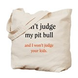 Don't judge my pit bull and I Tote Bag