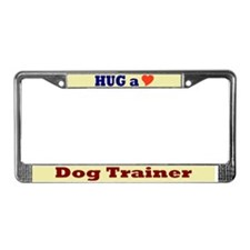 Hug a Dog Trainer License Plate Frame