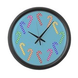 Row Of Rainbow Candy Canes Large Wall Clock