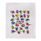 ABC Dinos Throw Blanket