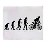 cycling evolution Throw Blanket