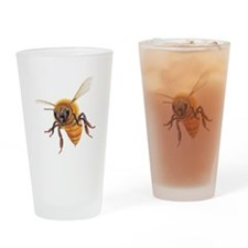 Bee in flight Drinking Glass