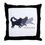 Running Huskies Throw Pillow