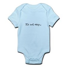 it's not easy... Infant Bodysuit
