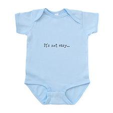 it's not easy... Infant Bodysuit