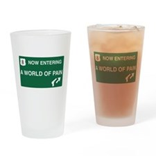 World of Pain Road Sign Drinking Glass