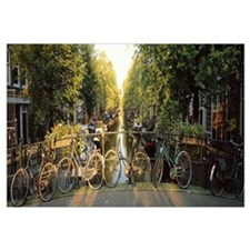 Netherlands, Amsterdam, bicycles on bridge over ca