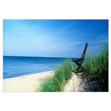 Michigan, Holland, beach chair overlooking Lake Mi