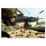 A Marine engages targets with an M249 Squad Automa