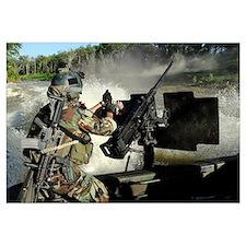A Special Warfare Combatantcraft Crewman reloading