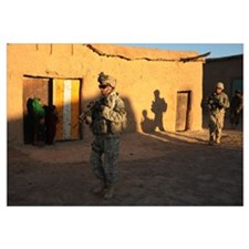 US Army Soldiers conduct a dismounted patrol throu