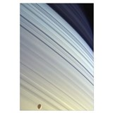 Mimas drifts along in its orbit against the azure
