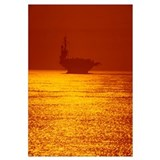 Aircraft carrier at sunset