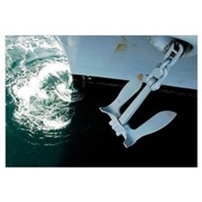 The port side Mark II Stockless Anchor is raised a