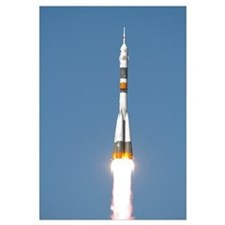The Soyuz TMA12 spacecraft lifts off into a cloudl