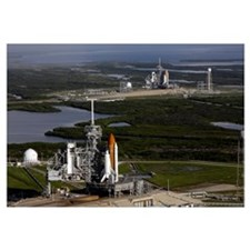 Space Shuttle Atlantis and Endeavour sit on their