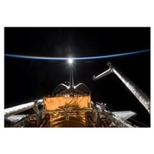 Space Shuttle Atlantis payload bay backdropped by