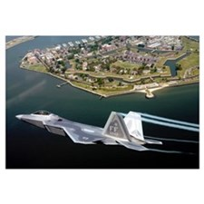 A F/A 22 Raptor flies over Fort Monroe