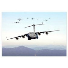 A formation of 17 C17 Globemaster IIIs fly over th