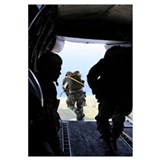 A US Army Soldier performs a staticline jump from