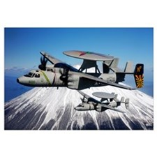 Two E2C Hawkeyes conduct a flyby of Mount Fuji in
