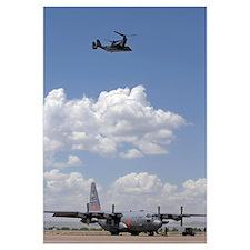 A CV22 Osprey flies over a C130 Hercules